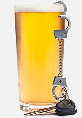 glass of beer with handfuffs and keys portraying a dui arrest